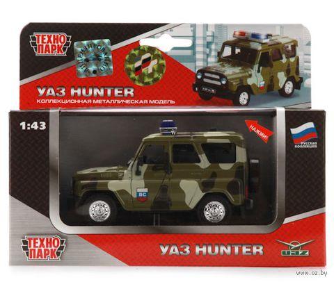 """Модель машины """"Уаз Hunter. Военная с сиреной и мигалками"""" (масштаб: 1/43)"""